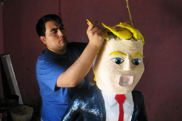 Dalton Javier Ramirez, a 28-year-old piñata maker from Reynosa, Mexico, works on his popular new creation — a piñata of Republican presidential candidate Donald Trump.