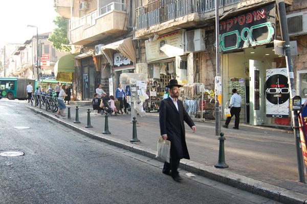 <strong></strong>In the ultra-Orthodox Jewish neighborhood of Mea Sharim, men wear dark pants, long dark coats and black hats.