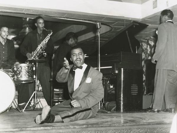 During its heyday, the Dew Drop played host to some of the greatest black entertainers around. Pictured here are Joe Fox on drums, Joe Tillman on sax, Curtis Mitchell on piano and an unnamed dancer.