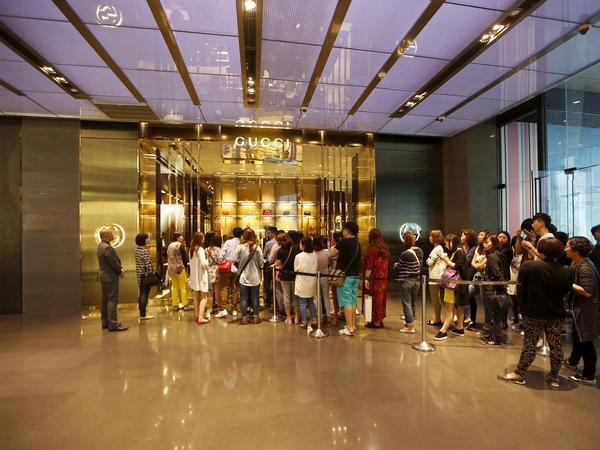 Customers line up to enter the Gucci shop at a mall in Shanghai.