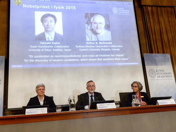 Professors Anne L'Huillier, left, Goran K. Hansson and Olga Botner, right, announce the winners of the 2015 Nobel Prize in Physics, in Stockholm, on Oct. 6.