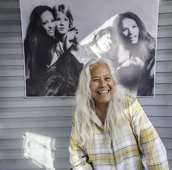 June Millington in front of a photo of her band Fanny at Fanny's House of Music in East Nashville.