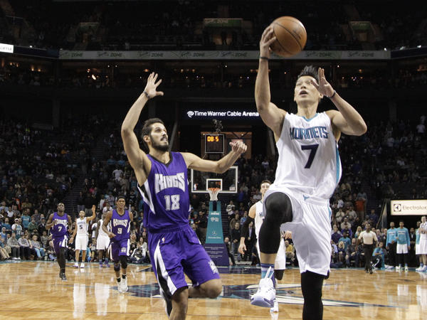 Charlotte Hornets' Jeremy Lindrives past Sacramento Kings' Omri Casspi in the second half of a game on Nov. 23. The Hornets won 127-122 in overtime. The Kings haven't won a championship since 1951.
