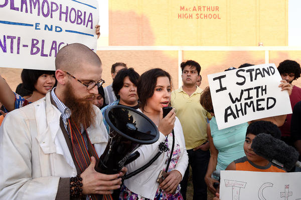Aisha U-kiu, president of American Muslim Professionals of Dallas and a graduate of MacArthur High School, speaks at a September prayer vigil in support of Ahmed Mohamed in Irving, Texas. Ahmed, 14, a student at MacArthur, was arrested there when a clock he built and brought into the building was mistaken for a bomb by teachers and police.