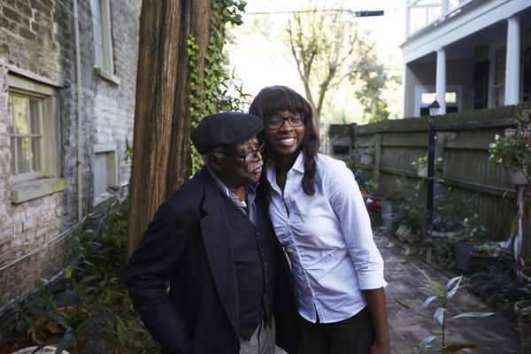 "Judge Richard Fields, affectionately known as ""The Judge"" to his family, and LaCurtia Brown embrace outside of Liz and Albert Alston's home."