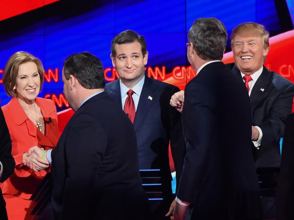 Republican presidential candidates (from left) Carly Fiorina, Chris Christie, Ted Cruz, Jeb Bush and Donald Trump interact onstage at the end of the Republican Presidential Debate on Dec. 15.