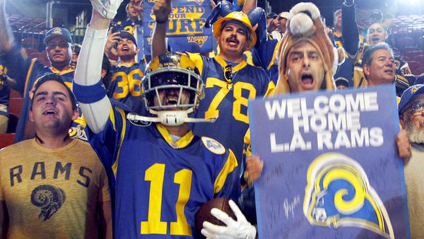 Fans cheer for the future Los Angeles Rams NFL team, during a news conference at the Forum in Inglewood, Calif., last Friday. The Rams are returning from St. Louis in 2016 to play in the Los Angeles area.