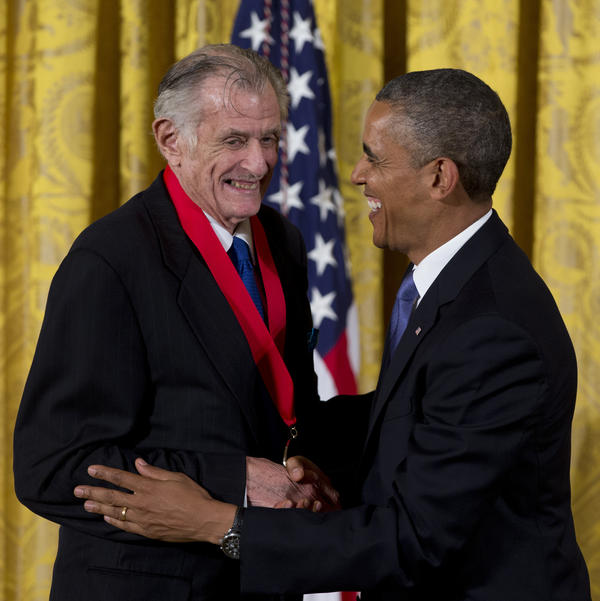 President Obama laughs with Deford as he awards him the 2012 National Humanities Medal for transforming the way people think about sports, during a ceremony at the White House in July 2013.