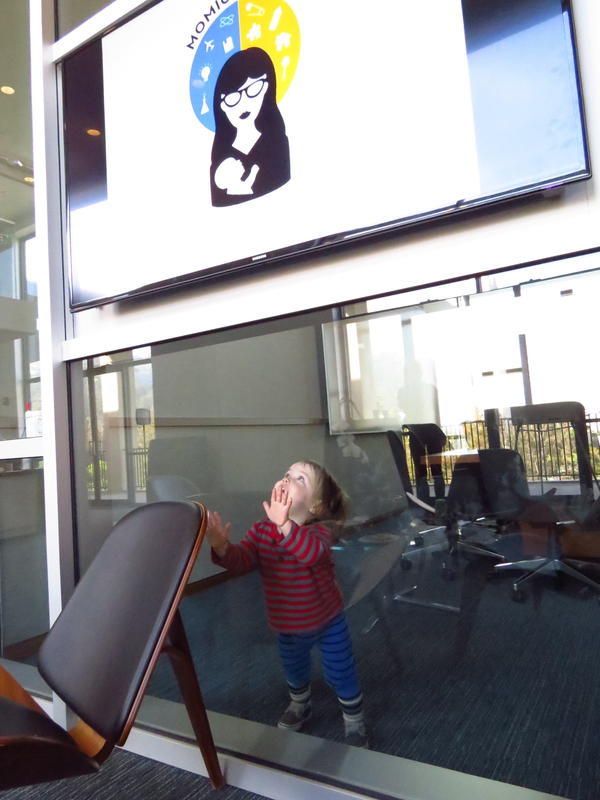 A one-year-old admires the conference logo as the opening reception begins.
