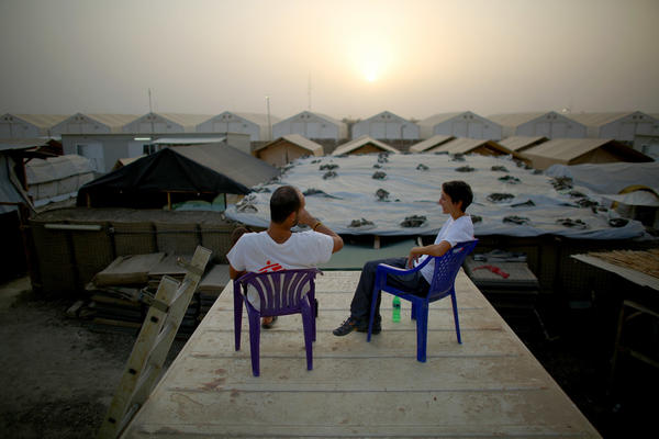Dr. Nav and Dickerson take a break on the roof of a shipping container at sundown.
