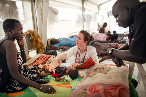 "Dutch doctor Jiske Steensma examines a patient. Working in the camp, she says, ""has really high highs and deep lows, but I'm happy to be here."""