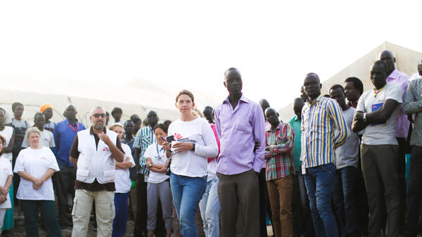 Stefania Poggi (center, in white jersey) oversees the morning meeting at the MSF hospital.