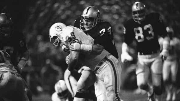 Dave Pear of the Oakland Raiders puts a stop to Larry Csonka of the Miami Dolphins after a 1-yard gain during fourth-quarter action on Oct. 9, 1979, in Oakland. The Raiders won 13-3.
