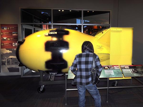 "A tourist at the Bradbury Science Museum in Los Alamos, New Mexico,  in February examines a full-size replica of the ""Fat Man"" atomic bomb which was dropped on Nagasaki, Japan, on Aug. 9, 1945. Los Alamos is home to the Los Alamos National Laboratory which was established in 1943 as part of the Manhattan Project."