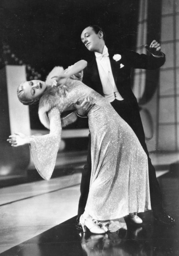 "Fred Astaire and Ginger Rogers dance in the 1936 film <em>Follow the Fleet. </em>The famous ""backwards and in high heels"" line came from <a href=""http://www.reelclassics.com/Actresses/Ginger/ginger-article2.htm"" target=""_blank"">this 1982 ""Frank and Ernest"" cartoon</a> by Bob Thaves."