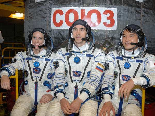 In the Integration Facility at the Baikonur Cosmodrome in Kazakhstan, Expedition 48-49 crewmembers (left to right) Kate Rubins of NASA, Anatoly Ivanishin of Roscosmos and Takuya Onishi of the Japan Aerospace Exploration Agency prepared for a four-month mission on the International Space Station in this June 2016 photo.
