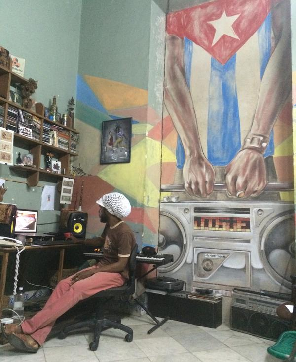 DJ Jigüe works in his studio.