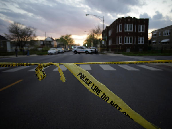 Police tape is displayed at a crime scene in Chicago where a 16-year-old boy was shot in the head and killed and another 18-year-old man was shot in April.