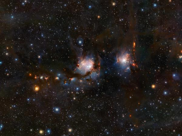 This detailed view of the star formation region Messier 78, in the constellation of Orion (The Hunter), was taken with the VISTA infrared survey telescope at ESO's Paranal Observatory in Chile. As well as the blue regions of reflected light from hot young stars, the image also shows streams of dark dust and the red jets emerging from stars in the process of formation.