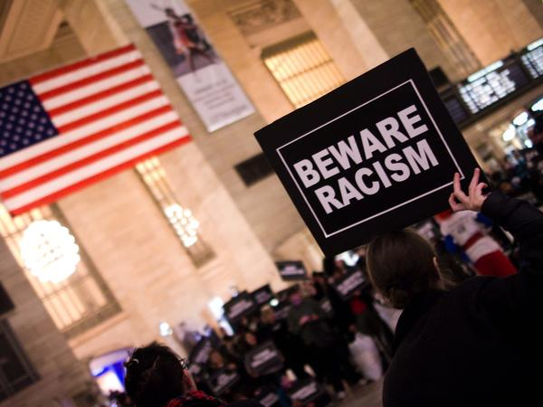 "A ""beware racism"" placard seen in New York's Grand Central Station. Is that racist?"
