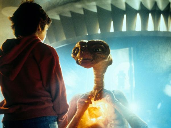 Elliott, played by Henry Thomas, talks with E.T. in a scene from the 1982 movie <em>E.T. the Extra-Terrestrial.</em>