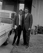 Baldwin with friend and civil rights leader Medgar Evers.