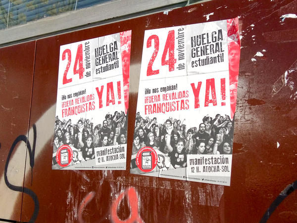 "Old posters on the wall of a school in San Cristóbal call on students to participate in a strike last November. The slogan warns, ""Get out of the way, Francoists!"" Spain's experience of decades of dictatorship helps protect against an embrace of the right wing now. Calling someone a <em>franquista</em> — a follower of the late, right-wing dictator Francisco Franco — remains an insult."