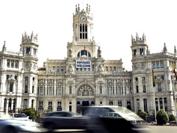 "A banner reading ""Refugees welcome"" hangs on the facade of the Madrid City Hall."