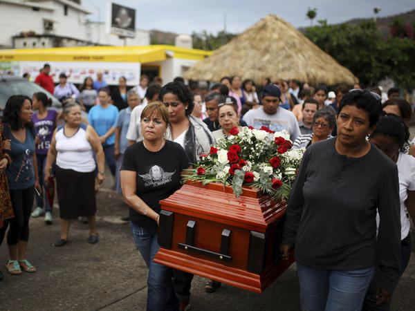 Members of a search group carry the coffin of Pedro Huesca as they walk to a cemetery in Veracruz, Mexico, on March 8. Huesca, a police detective, disappeared in 2013 and was found in a mass grave. His remains were among more than 250 skulls found over the past several months in what appears to be a drug cartel mass burial ground on the outskirts of the city of Veracruz, prosecutors said.