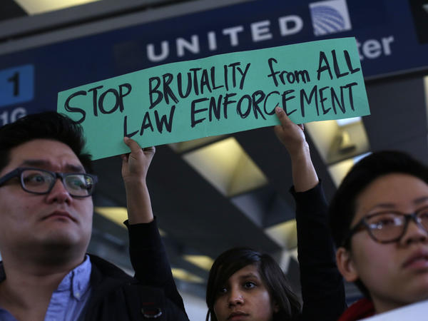 Demonstrators protest United Airlines at O'Hare International Airport on April 11, 2017 in Chicago, Illinois. The protest was in response to airport police officers physically removing passenger Dr. David Dao from his seat and dragging him off the airplane, after he was requested to give up his seat for United Airline crew members on a flight from Chicago to Louisville, Kentucky Sunday night.