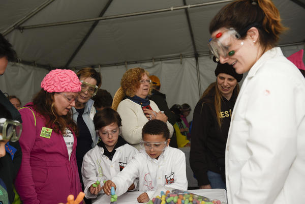 "Abralyn Weidow (left), Geyo and Stirling explore ""Magic Nuudles"" at the Kids Zone during the March for Science event in Washington, D.C."