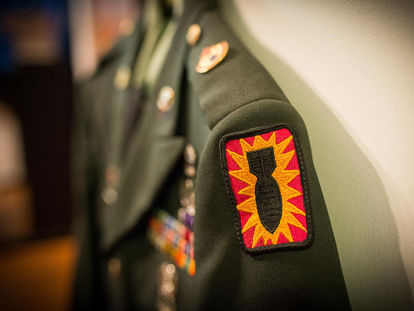 A close-up of the Explosive Ordnance Division patch on Michael Yandell's Army uniform.