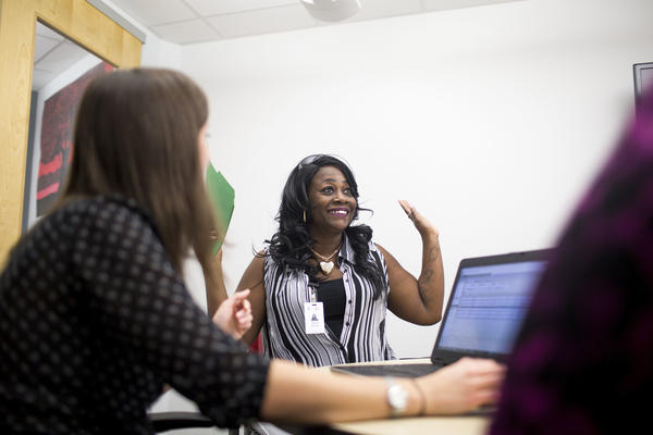 Katina Johnson celebrates during a meeting with her Goodwill Central Texas guidance staff to discuss higher education options.