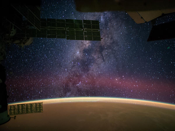 "Astronaut Reid Wiseman captured this image from the International Space Station and posted it on Sept. 28, 2014, writing: ""The Milky Way steals the show from Sahara sands that make the Earth glow orange,"" according to NASA's website."