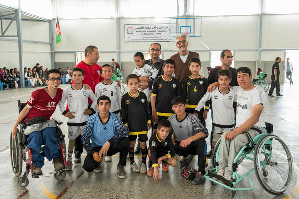 Alberto Cairo (back row in brown sweater) poses with his staff and players at a basketball tournament in Kabul, Afghanistan.
