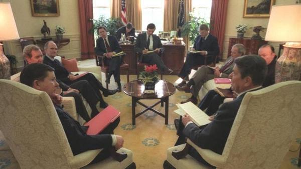 President Ronald Reagan meets with the Tower Commission, which investigated the Iran-Contra scandal. The three-member commission, chaired by former Senator John Tower, a Republican, was harshly critical of the White House staff.