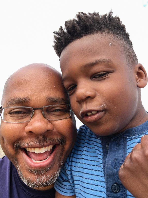 Darrow Brown, 52, with his son Lucas, 7, during a trip to the beach in April.