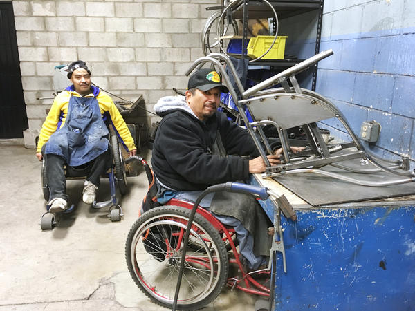 Gabriel Zepeda (right) makes an all-terrain wheelchair. He's been making wheelchairs for low-income Mexicans for 27 years.