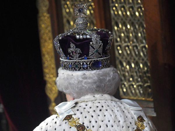Heavy is the head that wears the Imperial State Crown as Queen Elizabeth II is seen doing here on May 18, 2016. The crown weighs more than two pounds, writes NPR's Melissa Block.