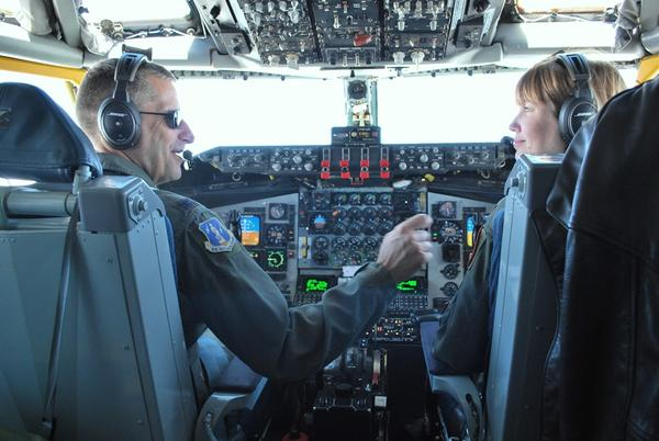 Col. Tom Jackson, Operations Group Commander, and Major Viveca Lane in the cockpit during the flight from Scott Air Force Base to refuel F-16s over Wisconsin.