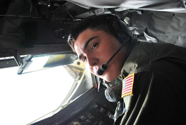 Boom operator Alberto Ayala in the boom pod of the KC-135.  He's a senior airman in the Air Force's 906th. He's one of about 100 active duty airmen who work with the 126th.