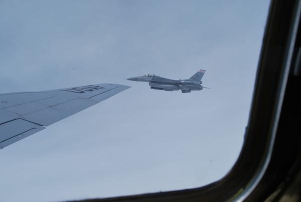 One of the Wisconsin Air National Guard's F-16s flies next to the KC-135.