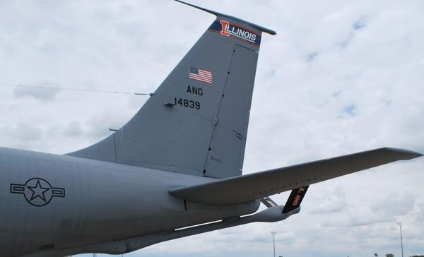 The boom is tucked under the back of the KC-135 and extended during refueling.