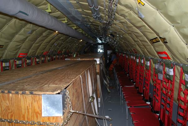 A view inside the massive KC-135. The plywood boxes can be collapsed flat on the floor when not carrying cargo.
