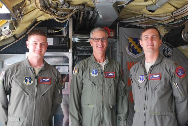 From left to right, boom operator Rich Bradford; Colonel Jeff Jacobson, vice wing commander of the 126th ; and Chris Robey, instructor pilot. They were part of a four-member crew for a training flight that was grounded because of high winds.