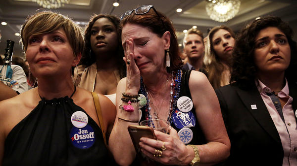 Jan Yanes (center) cries as  Democratic candidate Jon Ossoff concedes the special election for Georgia's 6th Congressional District Tuesday night.