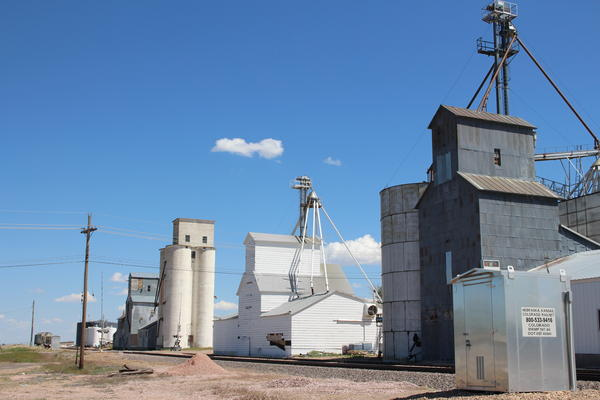 A series of elevators and grain storage buildings greet drivers into Haxtun, Colorado on the state's eastern plains.