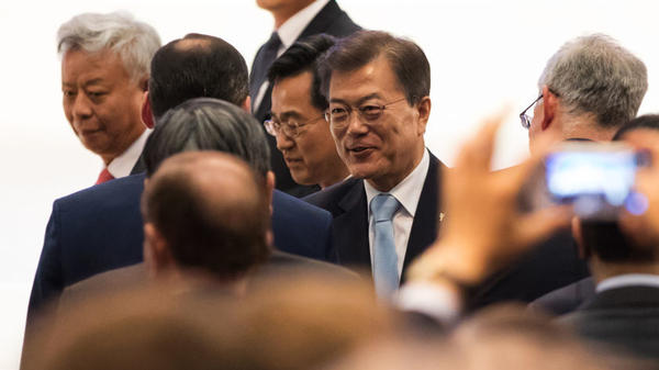 Moon Jae-in, South Korea's president, (center) will meet with President Trump on Thursday and Friday.