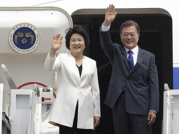 South Korean President Moon Jae-in and his wife, Kim Jung-sook, wave at the Seoul military airport in Seongnam, South Korea, on Wednesday before leaving for Moon's summit meeting in Washington with President Trump.