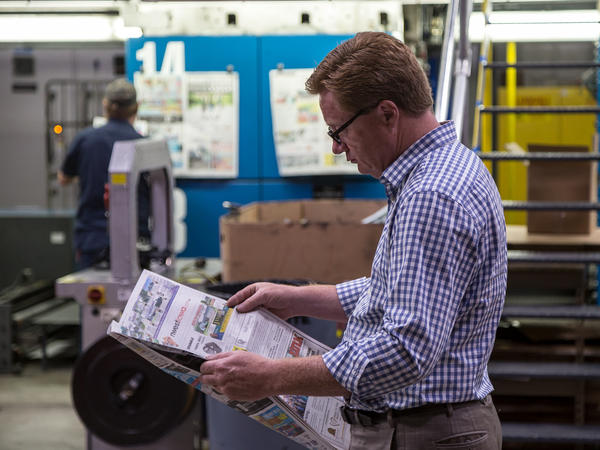 President of Iowa Information Publications and White Wolf Web Printers Jeff Wagner looks through a freshly printed newspaper at his large printing press in Sheldon, Iowa. Wagner's press prints about 80 newspapers a week. Wagner's company runs N'West Iowa News, The Sheldon Mail Sun and The Sioux Center News.